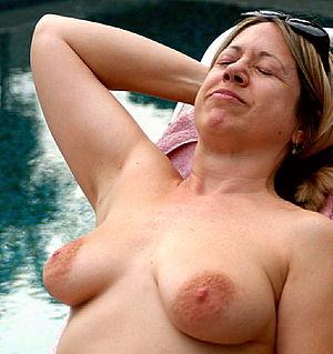 English: Topless sunbathing in sunny Palm Spri...